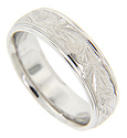 Swirling engraving ornaments this 14K white gold antique style men's wedding band