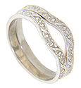 A floral pattern covers the surface of these 14K white gold curved wedding bands
