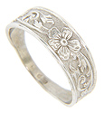 A flower design decorates the top of this 14K white gold wedding band