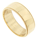 Polished diagonal strips are used to great effect on this 14K yellow gold modern wedding band