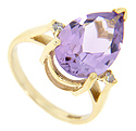 This faceted pear shaped amethyst is flanked on either side by a round diamond