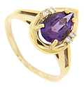 A pear shaped purple amethyst is flanked by four diamonds, two on each side