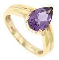 A pear shaped amethyst is set in this simple 14K yellow gold estate ring