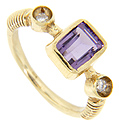 A rectangular amethyst is flanked by single diamonds on this 14K yellow gold estate ring
