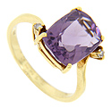 Two diamonds are set at diagonally opposite corners of a faceted amethyst in this 18K yellow gold estate ring
