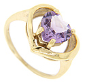 The pale purple amethyst in this 14K yellow gold estate ring has been faceted into the shape of a heart