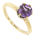 A single round faceted amethyst is set in this 14K yellow gold estate ring