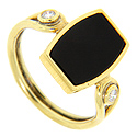 A geometric piece of onyx is set on this 18K yellow gold vintage ring