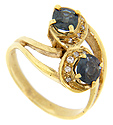 A pair of round sapphires is set in this 18K yellow gold antique ring