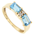 Two rectangular blue topaz are separated by two diamonds on this 14K yellow gold ring