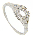 Diamond trios are set on the shoulders of this platinum antique style engagement ring mounting