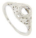 Lovely flower patterns decorate the sides and shoulders of this platinum antique style engagement ring mounting