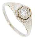 Crafted of 18K white gold, this antique style engagement ring is set with a .21 carat H color, Si2 clarity round diamond in an hexagonal head