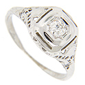 This 14K white gold antique engagement ring is set with a .35 carat, I color, Si clarity diamond