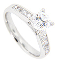 Four square diamonds are channel set in the engagement ring of this contemporary wedding set