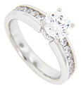 Round diamonds are channel set in the engagement ring of this contemporary wedding set