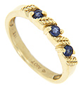Diagonal wheat sheaf designs separate three blue sapphires across the top of this 14K yellow gold modern wedding band