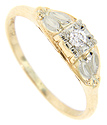 Marquis shapes in white gold ornament the shoulders of this 14K yellow gold antique engagement ring