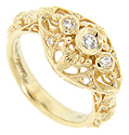 A diamond trio glistens across the top of this antique style 18K yellow gold engagement ring