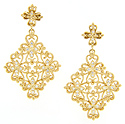 Curving floral designs set with diamonds ornament these 18K yellow gold antique style earrings
