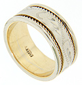 An engraved floral pattern is flanked by recessed yellow gold rope designs on this 14K white gold estate wedding band