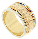 A repousse floral design is flanked by spiraling rope patterns on this 14K bi-color gold estate wedding band