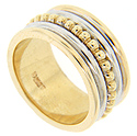 Yellow gold beads at the center of this estate 14K bi-color wedding band are flanked by white gold and yellow gold bands