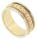 The central curving rose designs are crafted of yellow gold on this 14K bi-color estate wedding band