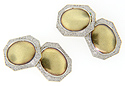 14K green gold ovals are surrounded by intricately engraved platinum frames on these antique cufflinks