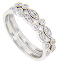 These antique style 14K white gold stackable wedding bands have approximately .10 carats total weight of diamonds set in a delicate pointed oval and circle pattern
