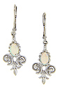 Delicate, pale opals are set in 14K white gold antique style earrings