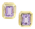 These lovely 14K yellow gold estate earrings show off emerald cut amethysts