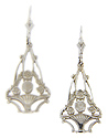 A basket and flower design is worked in these 14K white gold antique style earrings