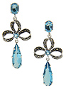 These sterling silver earrings have vibrant faceted blue London topaz are set on the top and dangling from each earring
