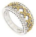 Criss-crossing lines of yellow gold set with yellow diamonds ornament this 14K white gold modern wedding band