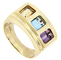 Rectangular citrine, blue topaz and amethyst are set in this 14K yellow gold estate ring