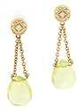 Faceted lime green quartz dangle from gold chains on these 14K yellow gold modern earrings