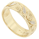 Engraved floral patterns and swoops of white gold accenting decorate this 14K yellow gold estate wedding band