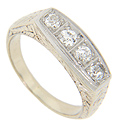 Four diamonds are set in a row across the top of this platinum retro-modern wedding band