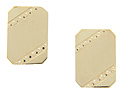 Rectangular in shape, these 14K yellow gold antique cuff links feature a diagonal geometric design