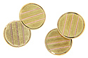 Diagonal lines of pink gold run across the surfaces of these circular 14K green gold antique cuff links