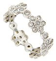 Clusters of diamonds form a floral design that spans the circumference of this antique style 14K white gold wedding band