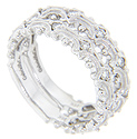 Curving white gold lines and beads provide additional ornamentation to the round diamonds set at intervals in this 14K white gold antique style stackable wedding band