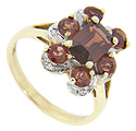 A rectangular garnet is surrounded by six faceted round garnets set in white gold on this 10K yellow gold ring