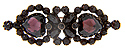 Faceted heart shaped garnets are surrounded by smaller round garnets on this antique red gold filled pin