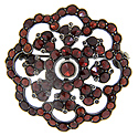 Curving, rounded edges outline this antique sterling garnet pin