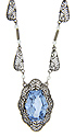 This sterling silver necklace has a spectacular synthetic blue topaz