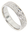 Crafted of 14K white gold, this antique style men's wedding band features a leafy wreath design at its center