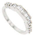 Baguette diamonds are set in the top of this 14K white gold antique style curved wedding band
