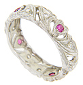 Heart shapes set with red rubies are spaced around the circumference of this 14K white gold estate wedding band